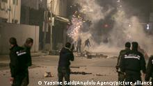 15.01.2021 *** TUNIS, TUNISIA - JANUARY 15: Tunisian people clash with police officers as they violate the curfew imposed to stem coronavirus (Covid-19) pandemic, during a protest against living conditions and unemployment at At-Tadaman district in the capital Tunis, Tunisia on January 15, 2021. Yassine Gaidi / Anadolu Agency