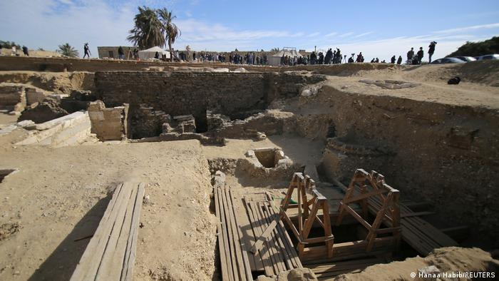 Looking into the excavation pit, including wooden structures over shafts