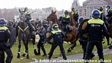 Police on horseback tackled protesters in Amsterdam