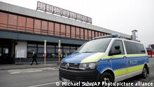 A police car is seen outside the Terminal 5 of the Airport Berlin Brandenburg (BER) in Schoenefeld