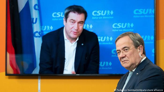 Председатели ХСС и ХДС Маркус Зёдер (на экране) и Армин Лашет