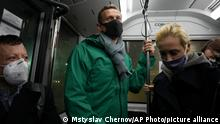 Alexei Navalny, centre, and his wife Yulia travel an airport bus as they arrived to airport Sheremetyevo