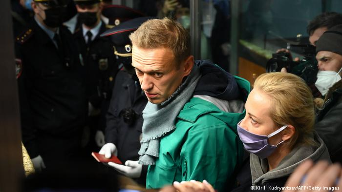 Russian opposition leader Alexei Navalny and his wife Yulia are seen at the passport control point at Moscow's Sheremetyevo airport