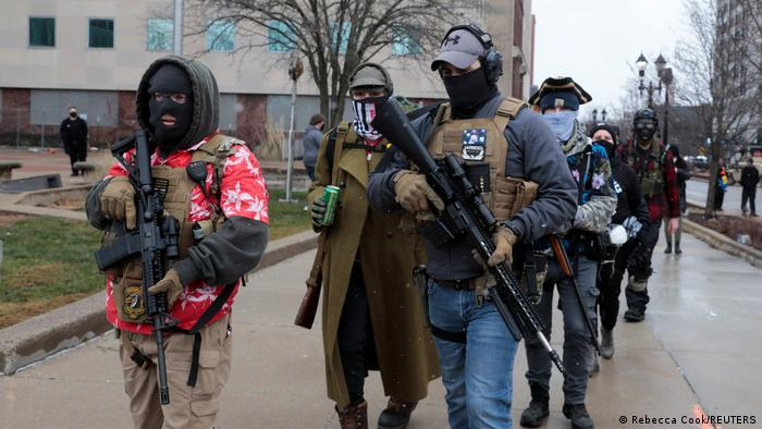 Armed members of The Boogaloo Bois outside the Michigan State Capitol in Lansing