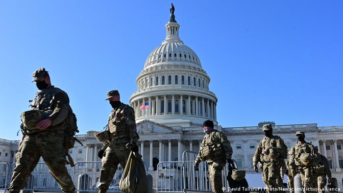 Military personnel patrol near the US Capitol