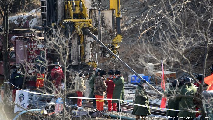 Rescuers drill a hole at the explosion site of a gold mine