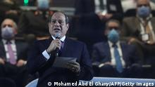 Egyptian president Abdel Fattah al-Sisi (front) delivers a speech in grandstand before the opening match of the 2021 World Men's Handball Championship between Group G teams Egypt and Chile at the Cairo Stadium Sports Hall in the Egyptian capital on January 13, 2021. (Photo by MOHAMED ABD EL GHANY / POOL / AFP) (Photo by MOHAMED ABD EL GHANY/POOL/AFP via Getty Images)
