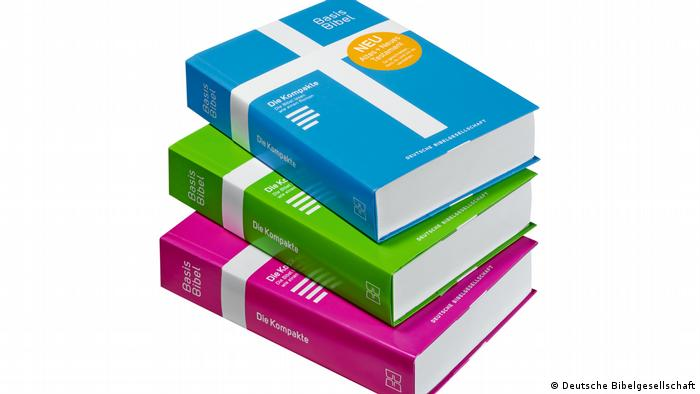 A stack of BasisBibel editions with colorful covers