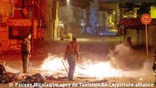 Protesters in Tunisia, fire breaking out