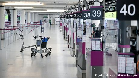 UK Edinburgh airport - empty trollies at the check-in counters