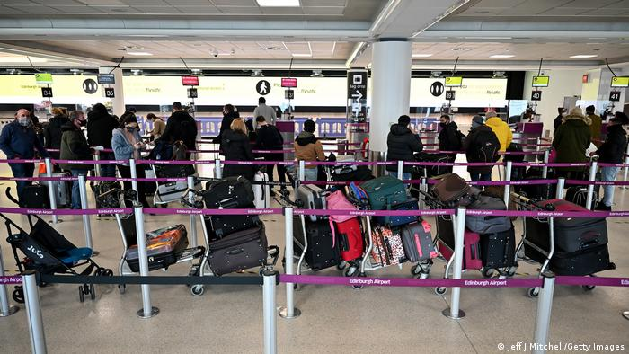 Lines of travelers at Edinburgh airport attempt to leave Scotland in mid-January