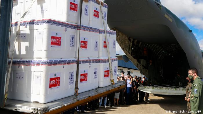 Brazilian soldiers load CoronaVac vaccines into a military plane at the Air Base of Sao Paulo
