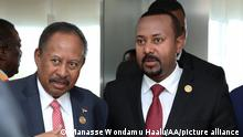 ADDIS ABABA, ETHIOPIA - FEBRUARY 09: Prime Minister of Ethiopia Abiy Ahmed (R) and Prime minister of Sudan Abdalla Hamdok (L) attend the opening session of the 33rd African Union Heads of State Summit in Addis Ababa, Ethiopia on February 09, 2020. This year the summit convened with the theme of 'Silencing the Guns by 2020', which includes economic, social and security issues in Africa. Manasse Wondamu Haalu / Anadolu Agency
