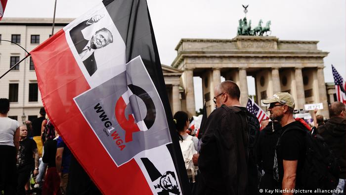 QAnon supporters gather in front of the Brandenburg Gate in Berlin during a protest