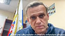 In this image taken from video released by Navalny Life YouTube channel, Russian opposition leader Alexei Navalny speaks in a police station outside of Moscow on January 18