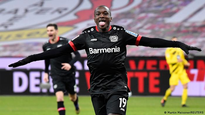 Bayer Leverkusen's Moussa Diaby celebrates scoring the opening goal against Borussia Dortmund