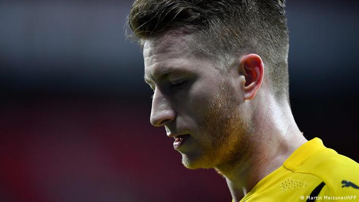 Borussia Dortmund captain walks off the field with his head down after defeat in Leverkusen