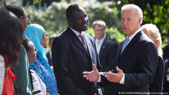 Joe Biden, in 2010, stands talking to people in Kenya