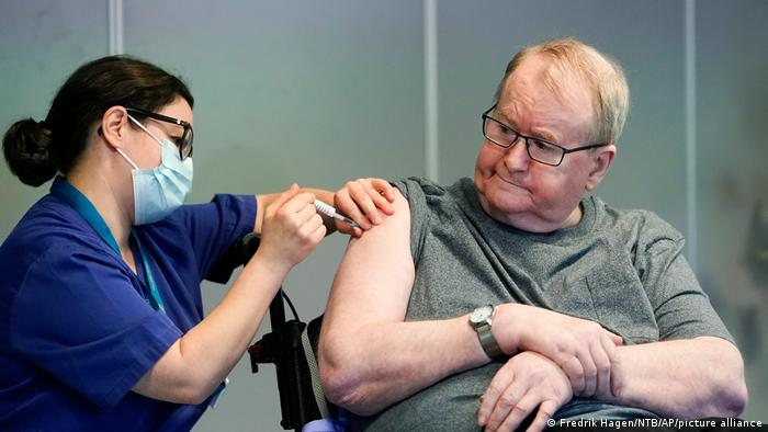 A man in Norway receiving a coronavirus vaccine