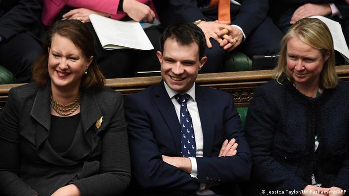 British MP Andrew Bowie (center)