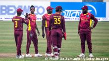 West Indies' cricketers celebrate the dismissal of Bangladesh's Liton Das during the first one-day international (ODI) cricket match between Bangladesh and West Indies at the Sher-e-Bangla National Cricket Stadium in Dhaka on January 20, 2021. (Photo by Munir Uz zaman / AFP) (Photo by MUNIR UZ ZAMAN/AFP via Getty Images)