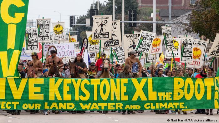 Demonstrators against the Keystone XL pipeline march in Lincoln, Nebraska