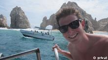 Check-in presenter Lukas Stege on boat tour at the Arco of Cabo San Lucas, Southern California