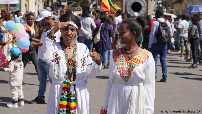 Gondar resident Tawobetch Alemayehu and her neighbor follow the procession of the Tabots — models of the Ark of the Covenant — to the Fasiledes Bath.