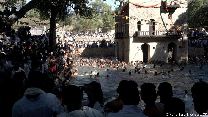 Men bathe in the holy water at Fasiledes baths