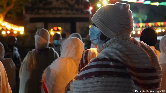 A man prays wearing a mask at the Timket festivities in Ethiopia