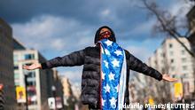 A supporter of U.S. President Joe Biden celebrates at Black Lives Matter Plaza
