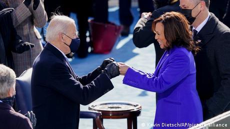 President Joe Biden and Kamala Harris fist-bump during the inauguration