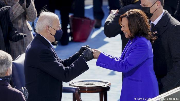 US President Joe Biden and Vice President Kamala Harris do a fist bump at the inauguration
