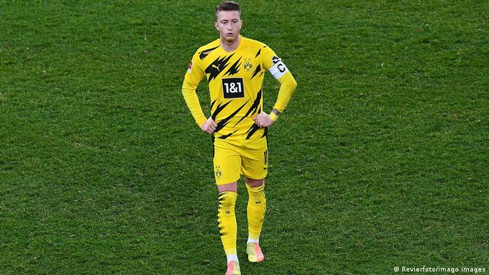 Borussia Dortmund captain Marco Reus walks off the field after defeat in Leverkusen