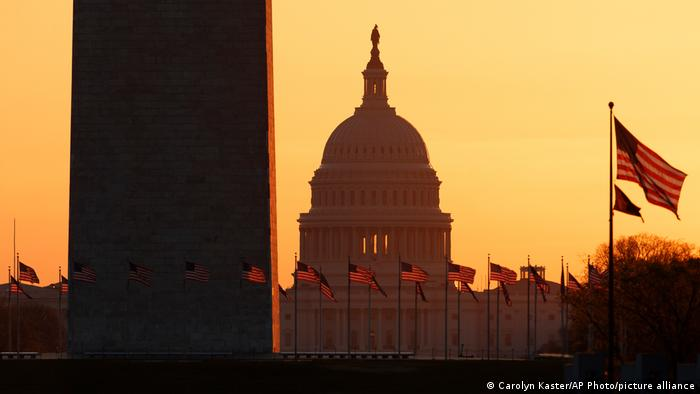 The Washington Monument and the U.S. Capitol are seen in Washington, at sunrise
