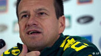 Former Brazil captain, now the national team coach, Dunga, speaks to the press before the 2010 World Cup