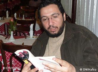 Belal Fadl reading aloud at Cafe Riche