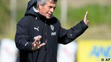 Uruguay's coach Oscar Tabarez talks to his players during a training session in Montevideo, Tuesday, Oct. 7, 2008. Uruguay will face Argentina in a World Cup 2010 qualifying soccer match in Buenos Aires on Oct. 11.(AP Photo/Matilde Campodonico)