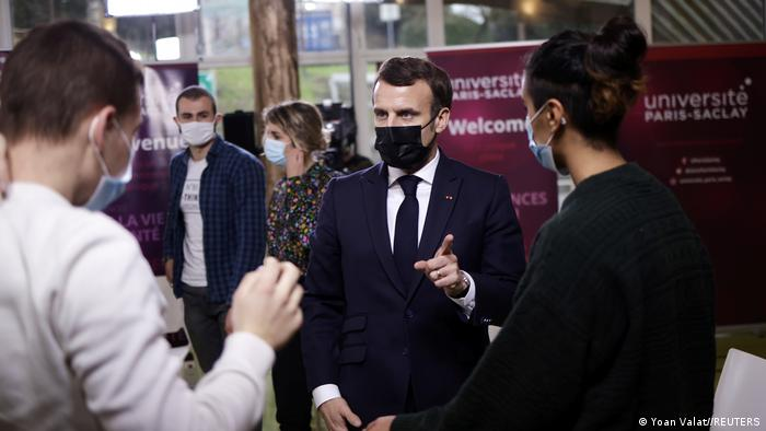 French President Emmanuel Macron talks with students at the Maison des Etudiants (Student House) of the Paris Saclay University in Saclay, near Paris