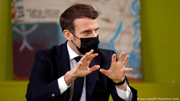 Emmanuel Macron wearing a face mask