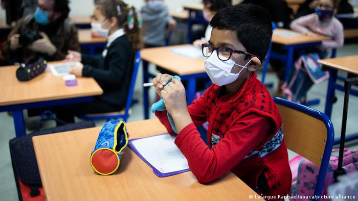 Pupils during class in an elementary school in Paris wearing face masks