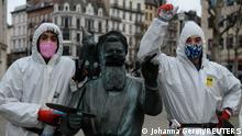 A pair of recently-jobless men, calling themselves the COVID boys, patrols in central Brussels to give advice about social distancing and mask wearing, amid the outbreak of the coronavirus disease (COVID-19), Belgium January 20, 2021. Picture taken January 20, 2021. REUTERS/Johanna Geron