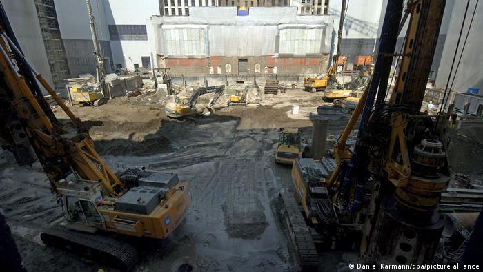 Berlin library construction work with bulldozers around a huge pit in 2005