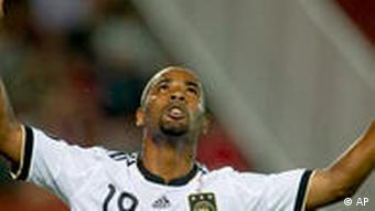 Brazilian-born Cacau celebrates scoring for Germany against Hungary in May 2010