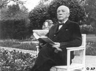 Richard Strauss sits in a chair in a garden