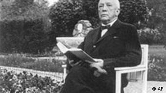 Richard Strauss sits in a chair in a garden