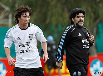 Argentina's coach Diego Maradona, right, and Lionel Messi are seen during a training session of Argentina's soccer team in Buenos Aires, Saturday, May 22, 2010.