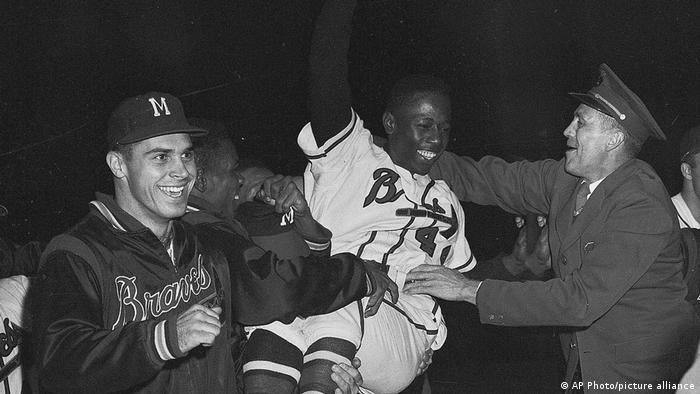 Hank Aaron hoisted by teammates