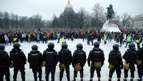 Police stand guard during a protest against the jailing of opposition leader Alexei Navalny in St. Petersburg