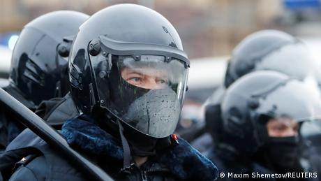 A law enforcement officer looks on during a rally in support of jailed Russian opposition leader Alexei Navalny